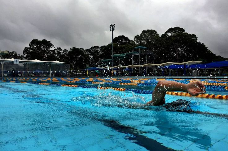 A lone swimmer doing laps on a rainy day at Lambton Pool. Picture: Simone De Peak