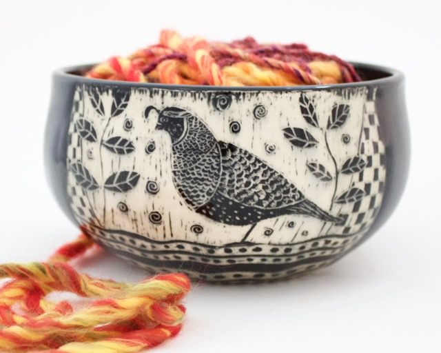 An etched quail is featured on this yarn bowl by Patricia Griffin in Cambria, Ca. Each one is handmade and has slot in back for yarn. Check them out online at patriciagriffinceramics.com