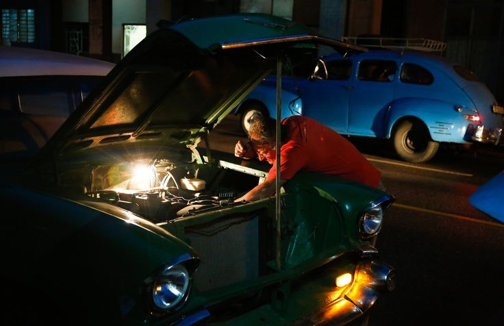 A taxi driver repairs his vintage American car. Although ingenuity, hard work and craftsmanship keeps Cubans' old cars running, their value does not hold up in the U.S. vintage car sales market. | #LatinCaribbean #Cuba