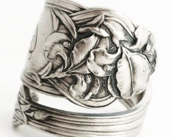 Wonderful high relief sterling silver spoon ring, made from an antique baby spoon with a unique spiral pattern!  This ring is detailed and ornate with a lovely Tea Rose Bud and surrounding leaves. Incredible detail with stunning Art Nouveau swirls throughout the entire design. This rare Spoon was bade by Watson Co in the part of original Flower of the Month Series No. 3 made in 1900! Roses, when given as a gift, are a romantic symbol of love and enduring passion. They can also represent the…