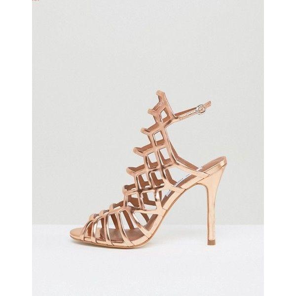 Steve Madden Slithur Rose Gold Caged Heeled Sandals (290 BRL) ❤ liked on Polyvore featuring shoes, sandals, caged heel sandals, rose gold shoes, steve madden sandals, heeled sandals and rose gold sandals