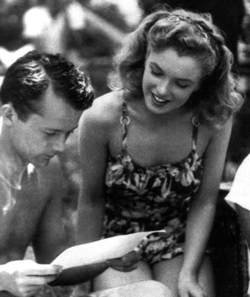 Marilyn Monroe and I believe that to be Arthur Miller.. loved death of a sales…