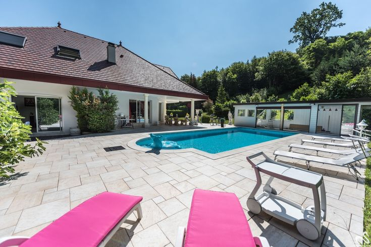 Amaizing villa realized by Companions - Sévrier - House - Sévrier - France - CHF 1260000 In protected frame, impressive property understanding living room  in the face of in front of the tiled swimming pool, bring down 300 m ², stone paved, walked entrance of size, magnificent bathroom,