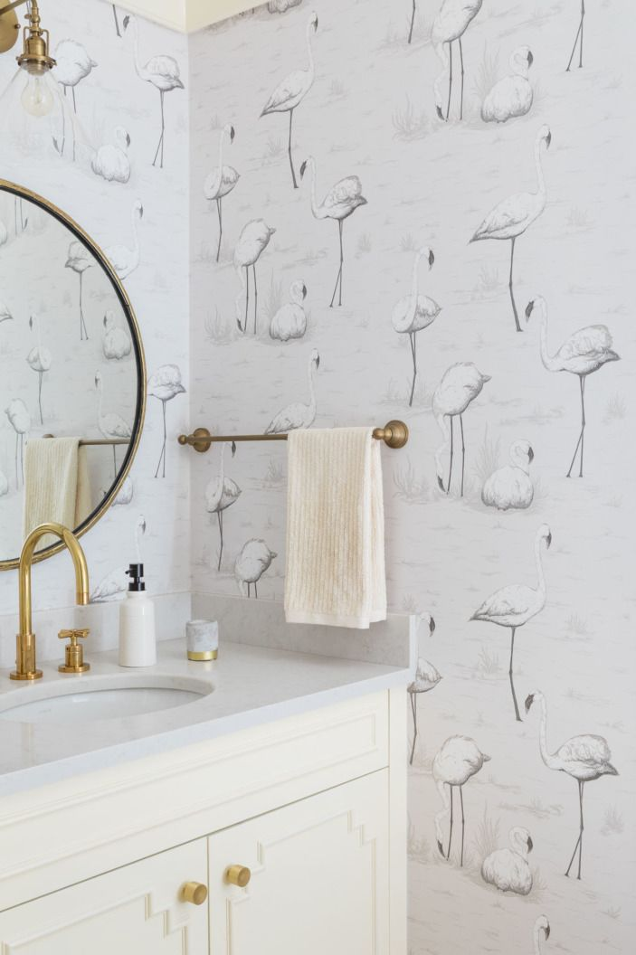 Who wouldn't want to look at flamingos in the bathroom?! We certainly would.