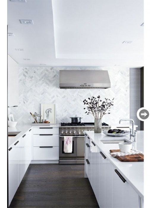 i like the white kitchen. its very bright and open. the stainless steel reminds me of my house and the amount of space is great for cooking