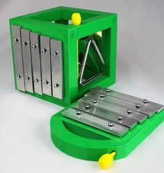 This handheld five note xylophone comes with an easy to store mallet. The bright emerald green xylophone housing, yellow mallet, and bolts are all 3D printed using PLA, a plant based biodegradable plastic.  #montessori #MadeintheUSA #3Dprinted #waldorftoys #kids #toys #musicaltoys #playground #outdoors