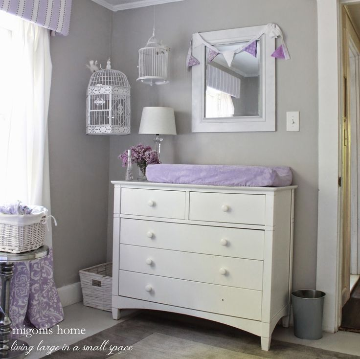 girls nursery in gray and lavender with hanging birdcages