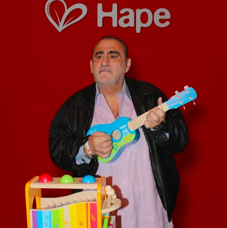 Hollywood Stars Love Hape .. Actor Ken Davitian from #Borat fooling around with #Hape #ukulele and our #poundtapbench for #babies #12m+  Ken is a Super Cool Guy! #ilovehape #woodentoys