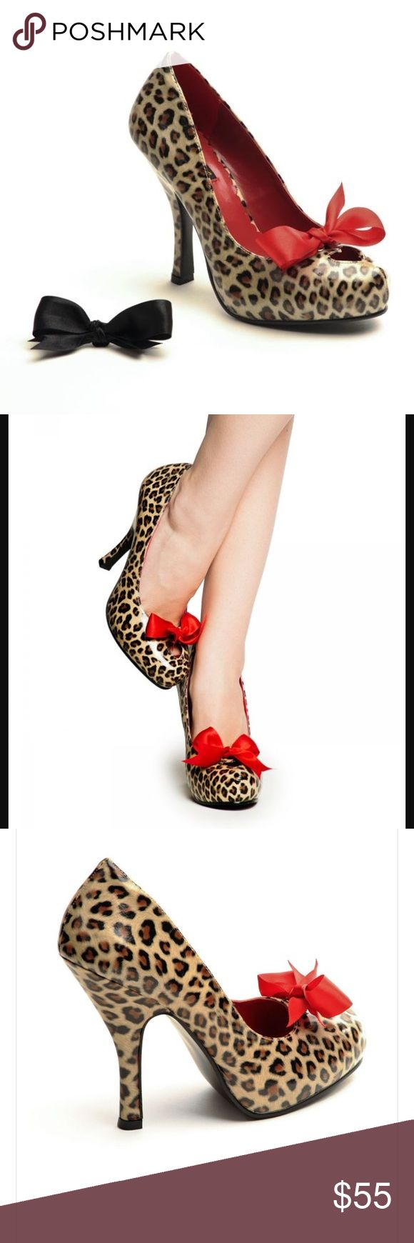 Pinup Girl Couture Cutie Pie cheetah heels-NEW! Pinup Girl Couture Cutie Pie cheetah heels-NEW! Brand new in box/ never used! Each shoe is wrapped in a bag and has red and black interchangeable bows! Beyond precious styling! 4.5 inch heels with a .75 inch concealed platform. Amazing heart detail in front! Perfect retro/ pinup shoe! Man made! Runs true to size! Pinup Girl Couture Shoes Heels