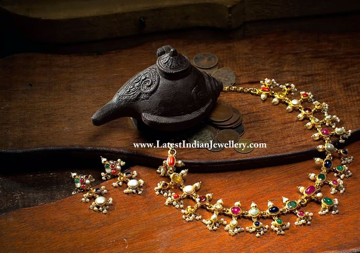 Stunningly beautiful with precious navatarna gemstones, this is a trendy and light choker necklace perfectly balanced with the colors complimented with small basara pearls