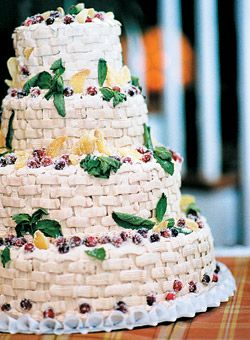 The vanilla and orange-zest cake with cranberry-orange filling from Deising's Bakery was frosted in a basketweave design with maple buttercream, & decorated with sugared cranberries, mint leaves, and candied ginger.