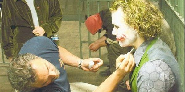 """Here you have Make-Up Artist John Caglione Jr. touching up the JOKER from """" THE DARK KNIGHT.""""  Heath Ledger won an OSCAR for his performance as the Crazy Clown but died 2 months before the Academy Awards at the age of 28. Like JAMES DEAN he passes away at the height of his career !"""