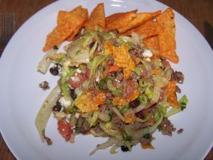 Recipe for Taco Salad with Doritos Here is a version of taco salad made with Doritos chips. It is amazingly tasty, quite easy to make and frugal. You will not regret the time invested in this recipe.