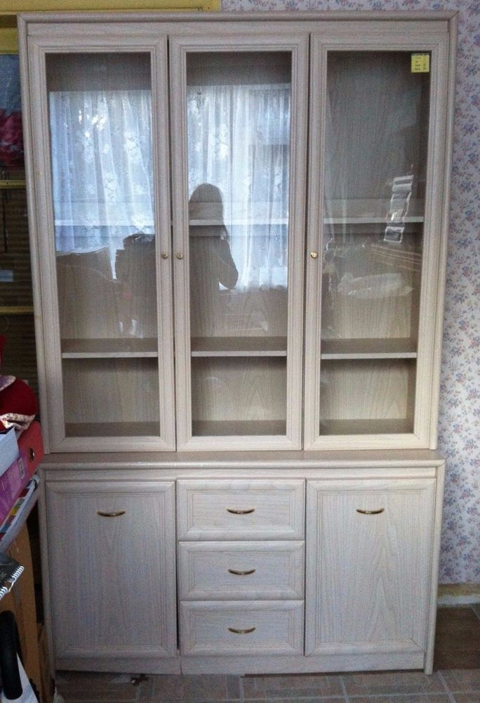 SILENTNIGHT Limed Beech Effect Three-door glass display cabinet with Base.
