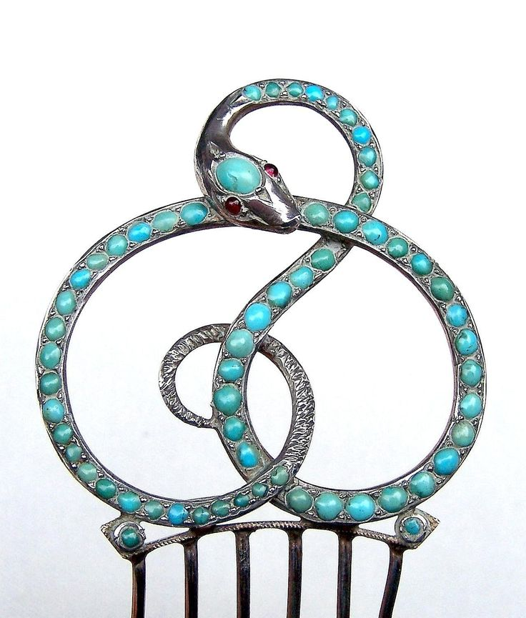 A pretty late Victorian hair comb in the form of a coiled serpent set with turquoise CONDITION: good vintage condition SIZE: 4 ins h x 2 ins w (10 x 5