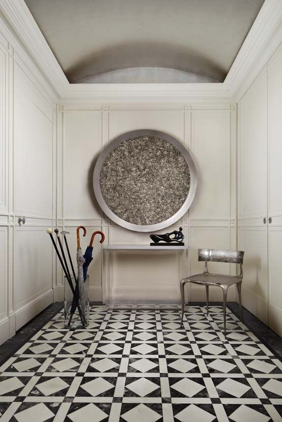 entry hall in nyc apartment black white tile floor love!