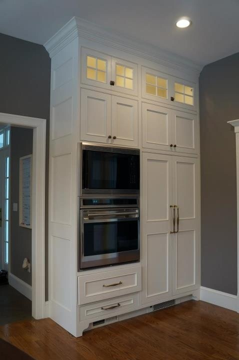 Custom Made By: Www.TaylorMadeCabinets.NET Glass Doors Over Tall Cabinets