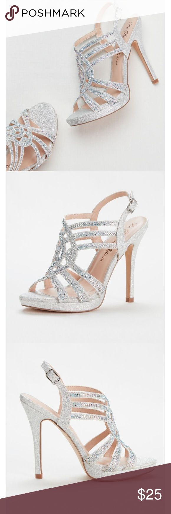 """Davids Bridal Strappy Crystal Platform Heels PROM Size 7. Only worn once as a bridesmaid in a wedding. The heels got sunken in the grass a bit but other than that they are perfect! Style: VIVA2 Instantly spice up your party look with these high-shining strappy platform sandals! These high heel strappy platform sandals are perfectly embellished with tiny dazzling crystals. Heel Height - 4.5"""". Fully lined. Imported. David's Bridal Shoes Heels"""