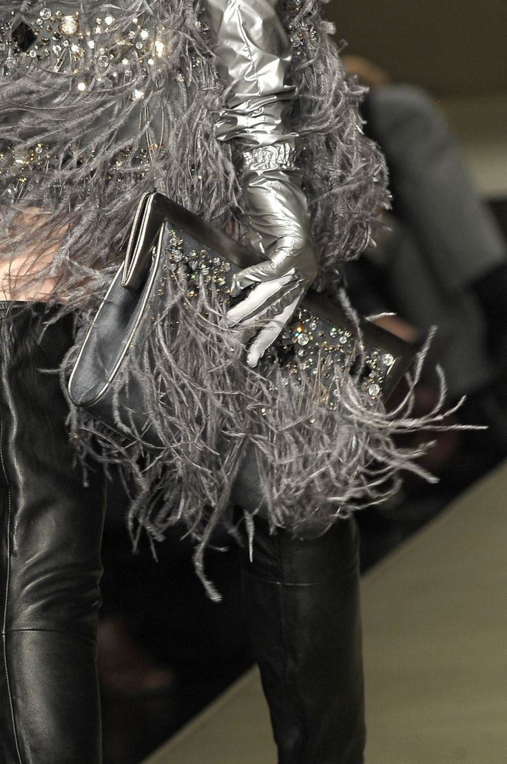 Krizia - Silver gloves & Purse against black leather. So chic.