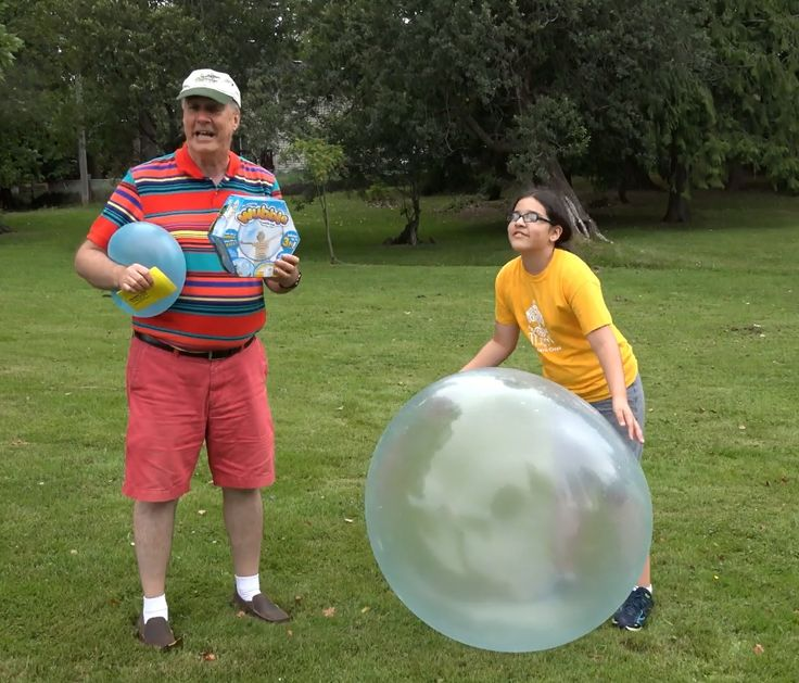 What's a Wubble Bubble Ball? We try out the newest As Seen On TV toy that is half bubble and half ball- http://epicreviewguys.com/Wubble-Bubble With all the bouncing, kicking and sitting on we do you would think the Wubble Ball would pop- but it is still going strong. We did have a hard time with inflating it- you really have to get serious with the tool that opens a tear in the plastic inner lining so you can inflate it. It seems like you are so close to popping it.