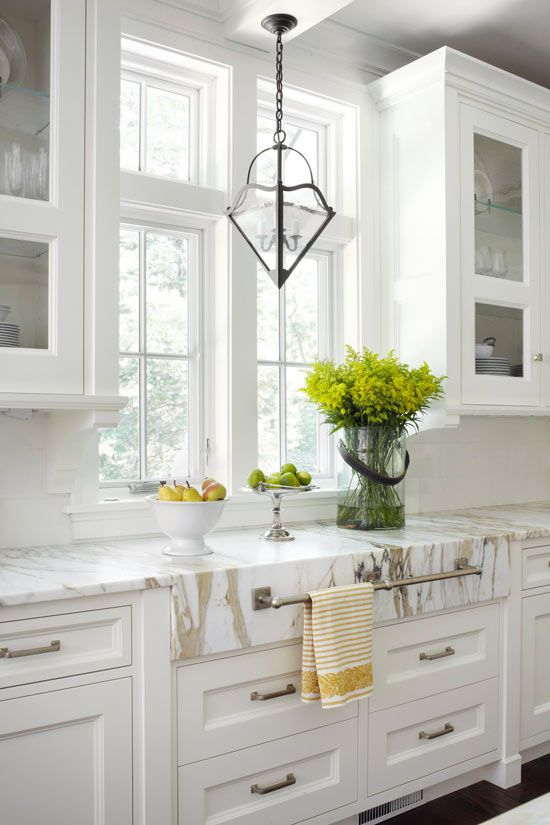 Calacatta Gold marble countertops with overhang and towel bar