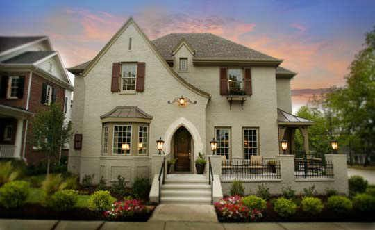 Painted Brick House that would match brown roof...this website has lots of good painted brick ideas