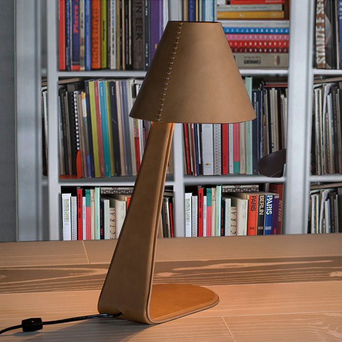 The design of this table lamp is contemporary and elegant and offers direct light. The steel structure of the lamp is entirely upholstered in high quality italian leather with a hand-sewn leather lampshade. The leather is available in multiple colors. - See more at: http://www.rivieraluxe.it/en/_6#sthash.LbTnmTGE.dpuf