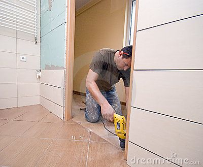 A man putting a new door to a bathroom. Part of home renovation project, see my portfolio.  <a href='http://www.dreamstime.com/interiors-rcollection4789-resi208938' STYLE='font-size:13px; text-decoration: blink; color:#FF0000'><b>MY INTERIORS COLLECTION »</b></a>  <a href='http://www.dreamstime.com/interiors-rcollection5192-resi208938' STYLE='font-size:13px; text-decoration: blink; color:#FF0000'><b>HOME BUILDING & RENOVATION »</b></a>