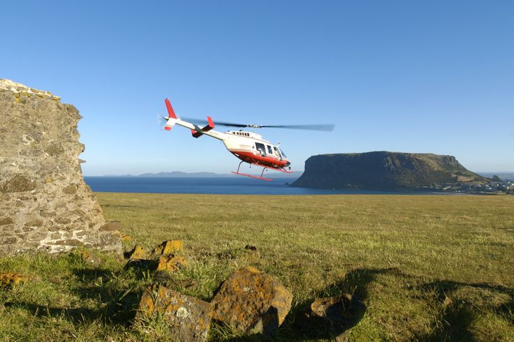 Tall Timbers scenic flights visit the stunning convict ruins and the iconic Nut at Stanley