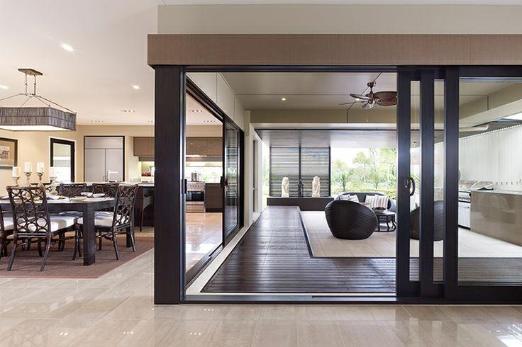 Dark chocolate timber stacker doors to Alfresco to match internals