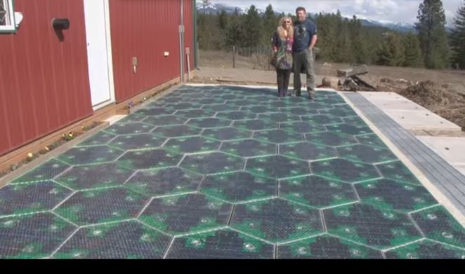 """Solar panels that you can drive, park, and walk on. Also heating elements to stay snow/ice free, LEDs to make road lines and signage, and attached Cable Corridor to store and treat stormwater and provide a """"home"""" for power and data cables."""
