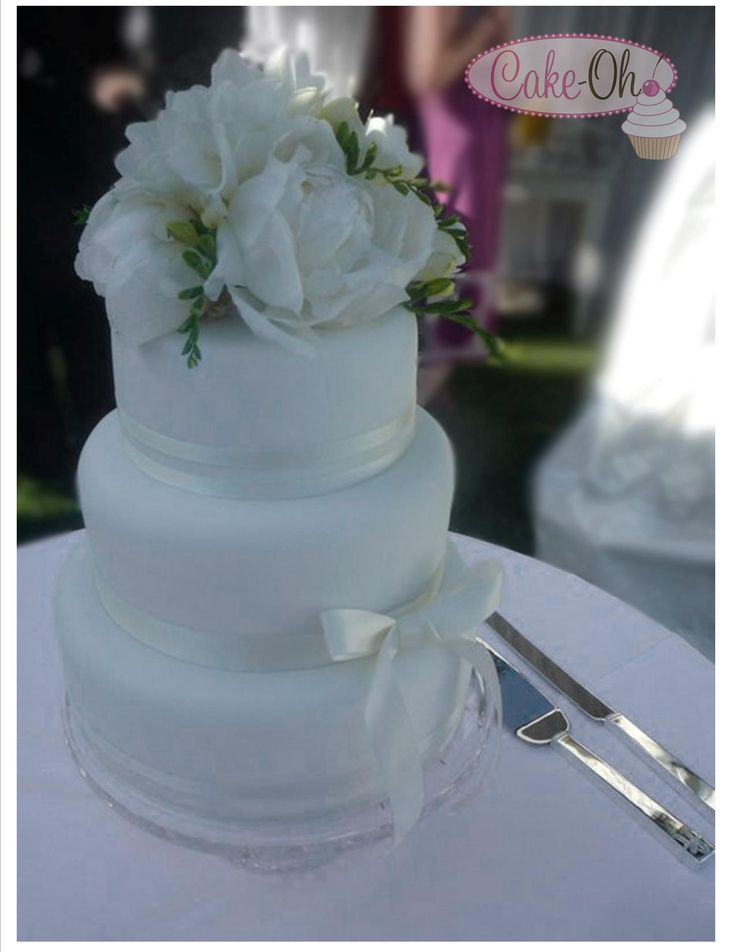 Summer Wedding Cake.  Gorgeous crisp, white fondant with fresh flowers.