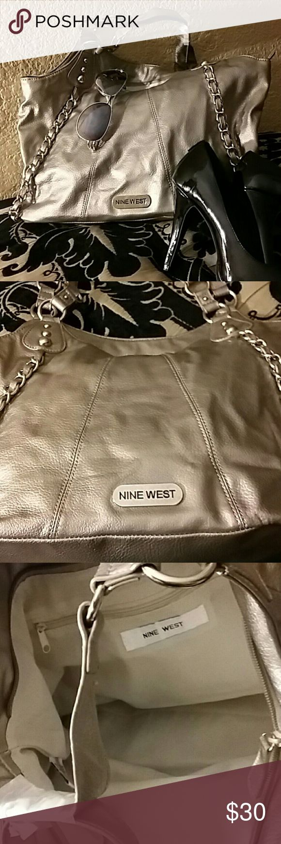 Nine West Silver/gold tone metallic handbag I had a really had time describing the color.... it has silver hardware and the overall color is silver but it has a gold tone to it. Almost a champagne color. Anyhow it is cute, never used and in great condition. Nine West Bags