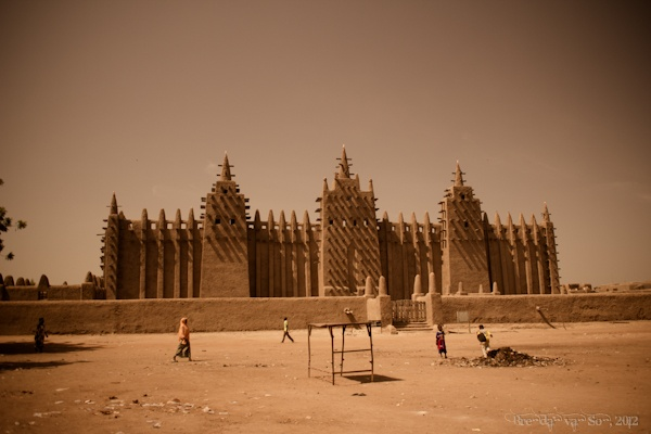 Grande Mosque of Djenne. Built in 1240 in Djenne, Mali. It has continous maintenance of the structure. The replastering of the walls is an annual event.