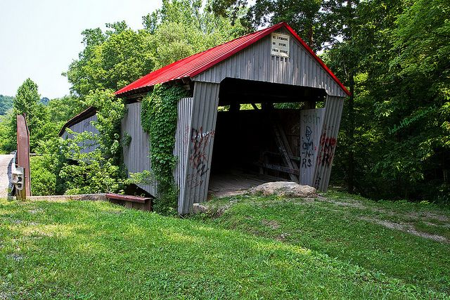 The Ohio Department of Transportation (ODOT) information on historic covered bridges gives Geer Mill, Humpback, and Ponn Covered Bridge as three alternate names, while the bridge's listing on the National Register of Historic Places gives only Ponn Humpback Covered Bridge (one name, not two alternate ones). Built in 1874
