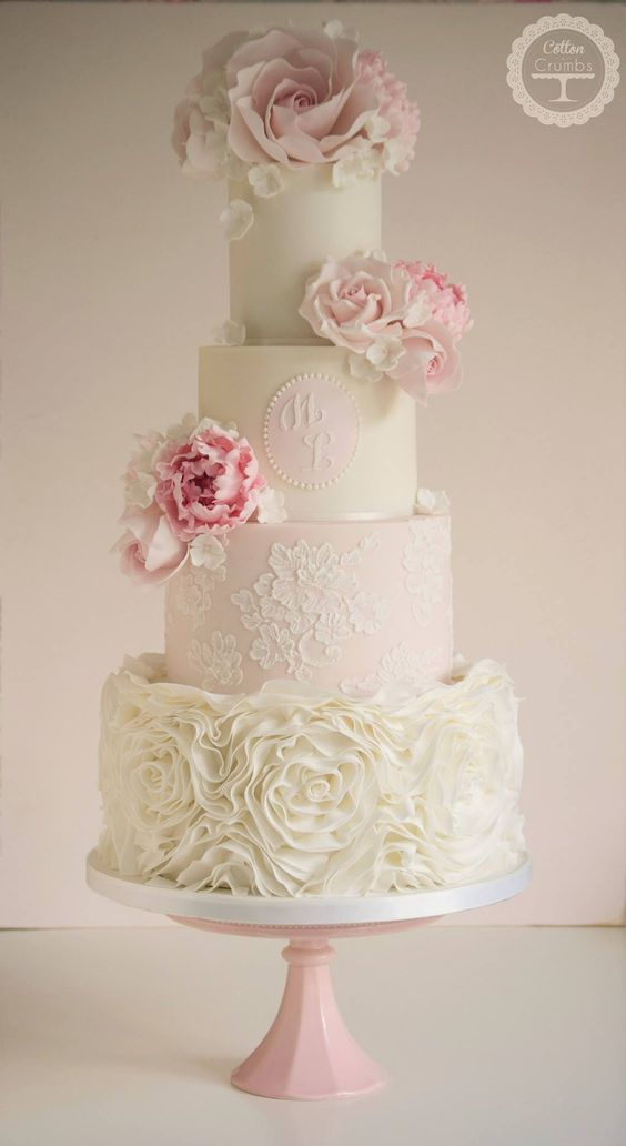 Gorgeous four tier pink and white wedding cake; Featured Cake: Cotton and Crumbs
