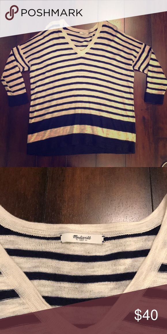 Madewell oversized stripped sweater Madewell Lightly used (maybe 4 times) Oversized and slouchy Blue and white stripped Slight high/low detail Madewell Tops Sweatshirts & Hoodies