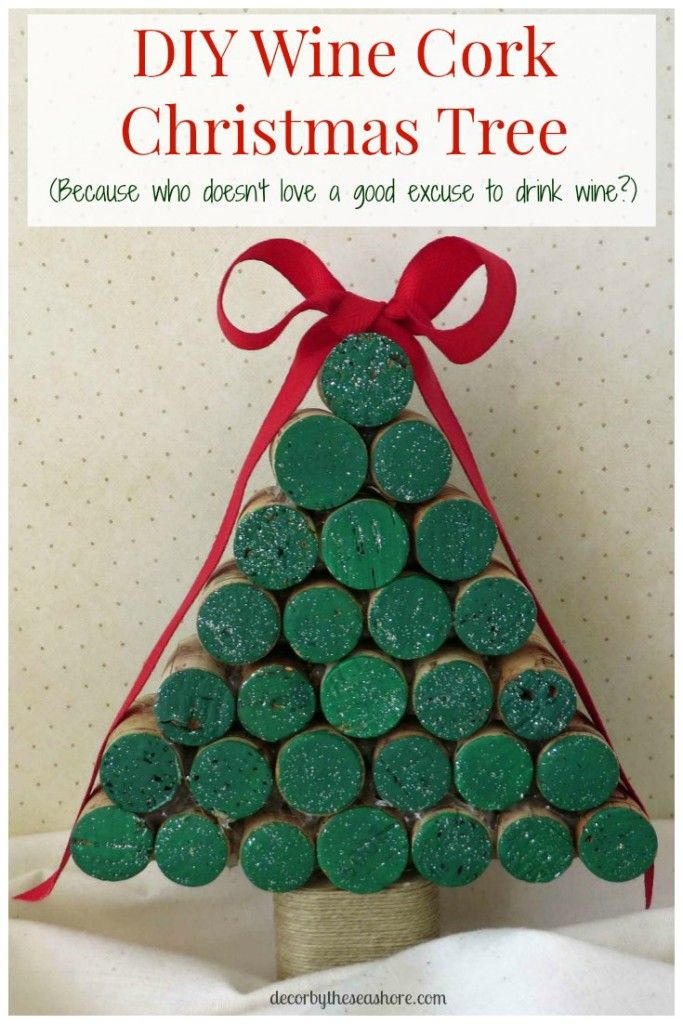 Create this gorgeous DIY wine cork Christmas tree for your home with this quick and easy tutorial! It will make a fabulous addition to your Christmas decor and a great gift for friends and family!   decorbytheseashore.com