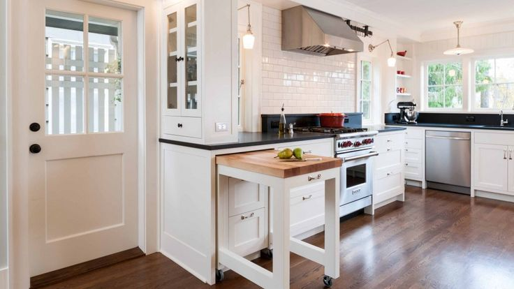 Kitchen Clever | JAS Design Build - pull out counter the fits back into cupboards