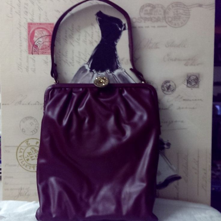 Vintage Early 1960\'s Maroon Vinyl Handbag on Velvet Rose's Pin Up Dressing Room  A beautiful vintage early 1960's Maroon Vinyl Handbag, lining is light brown satin . It is in excellent condition - it is deadstock and comes from a handbag manufacturer's warehouse. The measurements of the bag are width 20.5cm height 24 cm and depth 5cm. It is an unusual shape being more of a long style bag. There is an original old price tag still attached . Also there is original newspaper still in the bag…