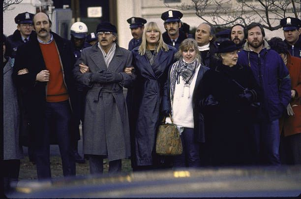 Paul Stookey Peter Yarrow and Mary Travers of folk group 'Peter Paul and Mary' and others marching during antiapartheid demo