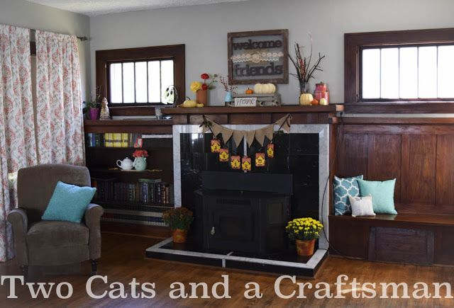 Two Cats and a Craftsman: Fall - using the colors in my home to decorate. Turquoise, Orange, Yellow, and Gray for Fall, Fall Decor, Craftsman, Wood Floors, mantel, pillows, banners