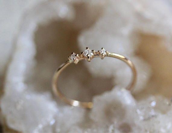 Sweet and delicate...like tiny flakes of snow when they first dance into your hand. Our Snow Dance ring features three tiny diamonds for a just a bit of sparkle! - Center diamond measure 2 mm - Side diamonds measure 1.3 mm - Ring Ct total is .05, diamonds are conflict free - Round band