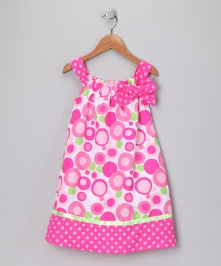 Cute pillowcase dress. I like how they used fabric instead of ribbon for the shoulder straps and then use the same ribbon for a bow and the hem.