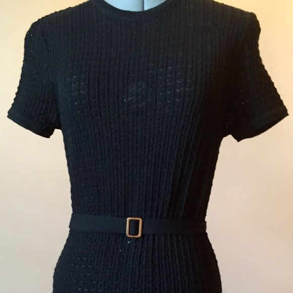 """Black Knit Belted Dress by Issac Mizrahi Beautiful dress. Very sophisticated. 100% wool but not itchy. Black tightly knitted dress that fits like a glove. Belt at waist with gold buckle. Hits around my calves and I'm 5'2"""". Recommend wearing a black slip under it. I felt like a million bucks every time I wore it! Good condition. No imperfections or spots. Isaac Mizrahi Dresses"""