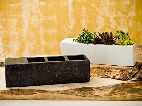 """The 3 series is a line of small, handmade concrete container with 3, 3""""x3"""" planter openings. The 3 Series is perfect for a coffee table presentation or a windowsill."""