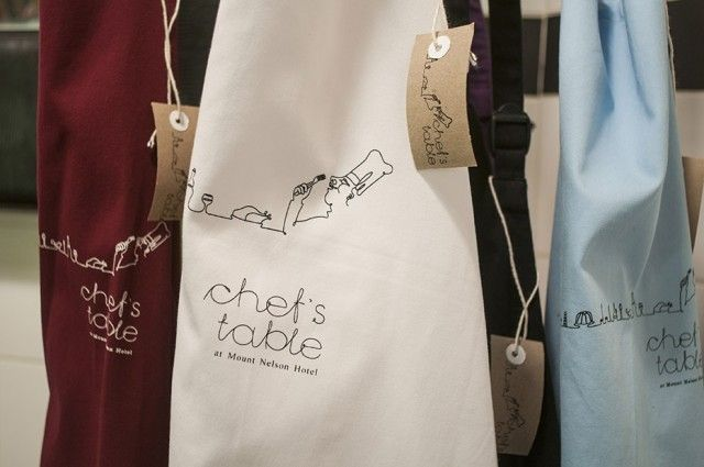"""Aprons made by Minted Ginger for The Chef's Table at The Mount Nelson. What is The Chef's Table?..... Its  """"a custom-designed, interactive culinary experience featuring Mount Nelson's finest cuisine and wines.While seated at an oak table in an alcove of the hotel kitchen, complete with an oversized mirror affording a perfect view of the chefs at work you watch the chefs prepare specific dishes and discuss the recipes and the inspiration behind them."""" Not to be missed."""
