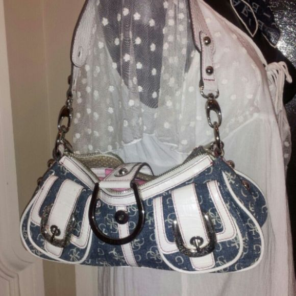 Denim Guess bag Stunning will be hard to run into yourself two outside flap pockets and one zipper pocket in rear inside a zipper pocket as well mint .  Has two different straps and length im straps that can be used. Guess Bags