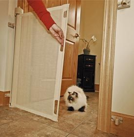 The retractable cat gate can easily be operated with just one hand