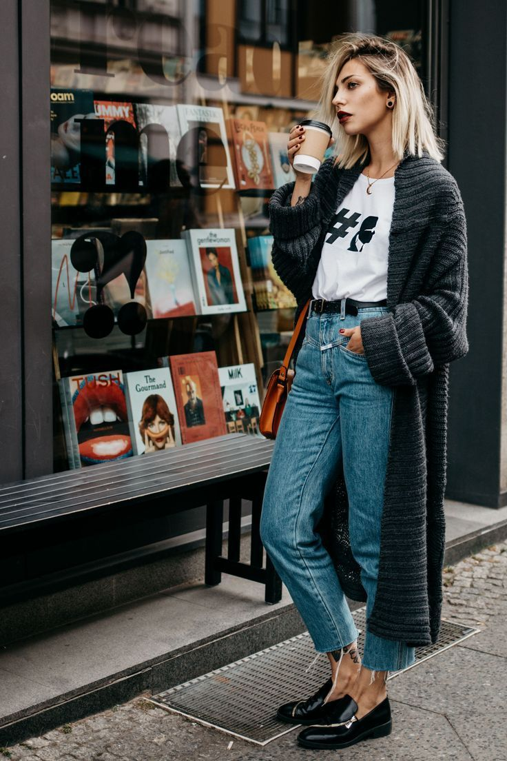 Mom jeans, black brogues, long chunky grey cardigan, white logo tee. Simple street style.